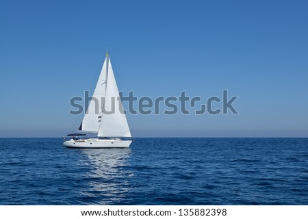 Racing yacht in the Mediterranean sea on blue sky background