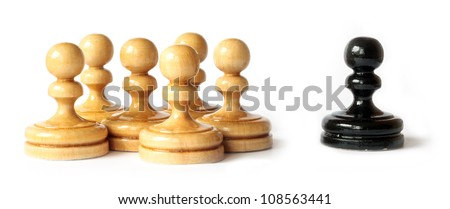Racism between black and white pawns isolated on white background