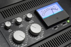 Rack audio compressor of sound recording studio close up. Making music in the professional studio. VU meter close up.