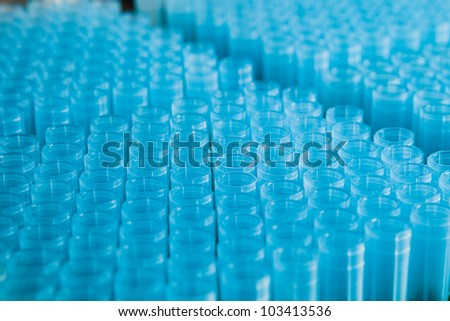 rack of blue plastic pipette nozzles made of polypropylene
