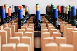 Rack of bottles of wine with blank label