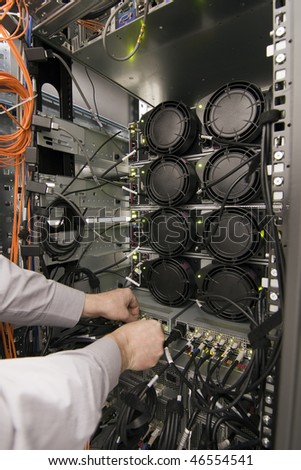 Rack of computer network equipment, rear view - stock photo