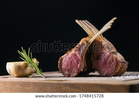 Rack of freshly grilled new zealand organic lamb cooked medium rare and put on a wooden plate and shot by professional food photographer Zdjęcia stock ©