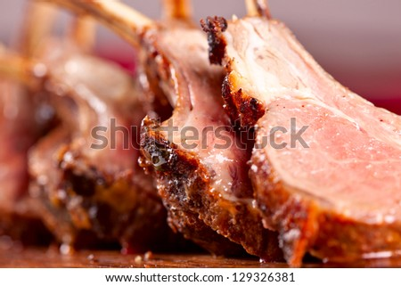 Rack of lamb fried with aromatic olive oil, herbs and spices