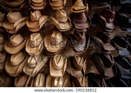 Rack of straw cowboy hats