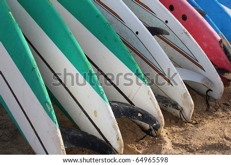 Rack of Surfboards on the Beach