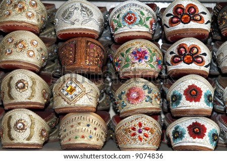 stock photo Rack of traditional Indian shoes made of camel skin and