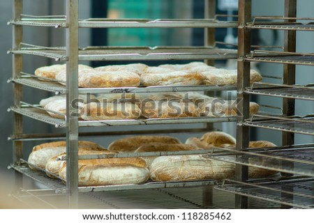 Rack trolley with baked bread in department of supermarket