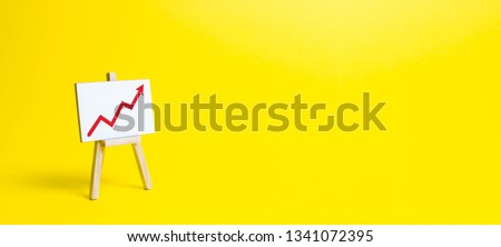 Rack with a red arrow up on a yellow background. Business planning and revenue analysis. Indicators of business projects, level of profitability, liquidity. Increase efficiency, productivity. banner #1341072395