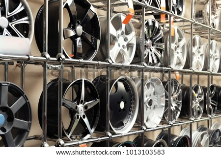 Rack with car wheels in automobile store #1013103583