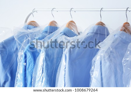 Rack with clean shirts in laundry #1008679264