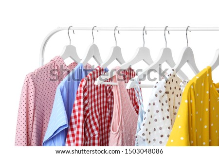 Rack with hanging clothes on white background #1503048086