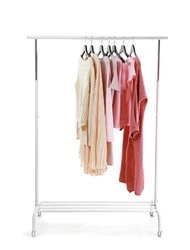 Rack with stylish clothes on white background