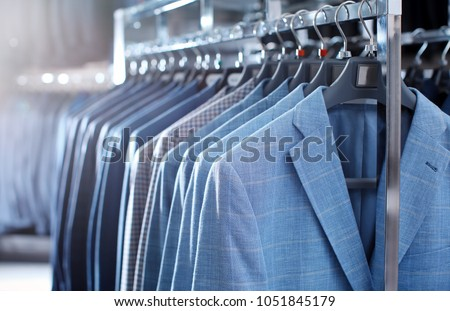 Rack with suit jackets in boutique #1051845179