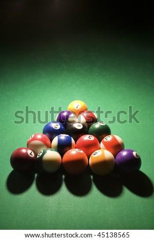 Racked pool balls on pool table. Vertical shot.