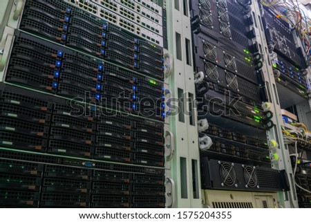 Racks with powerful servers are in the data center. The computer equipment of the Internet provider is in the server room. Hosting platform of a modern technology company. View from the bottom