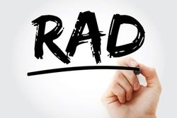 RAD - Reactive Attachment Disorder acronym with marker, medical concept background