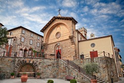 Radda in Chianti, Siena, Tuscany, Italy: the ancient church Propositura di San Niccolo and the old fountain in the Tuscan medieval town