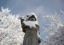 Radegast, Pustevny, Beskids, Czech republic, Czechia -  Statue of god from slavic mythology. Sculpture is covered by white snow in the winter. Shallow focus.