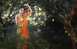 Radha, Hindu mythology character, dancing in a forest in a beautiful saree