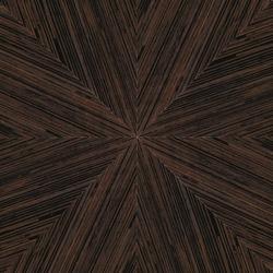 Radial starburst pattern in dark brown wood