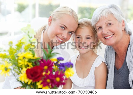Radiant family with flowers at home