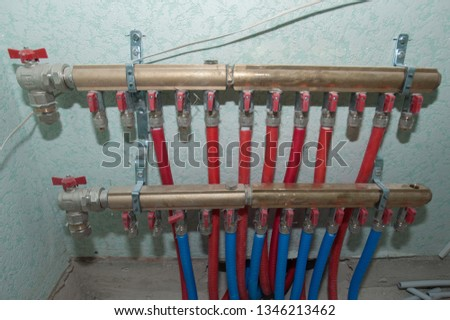 Radiant Floor Heating Installation Heating System. Man install underfloor water heating floor construction. Floor heating installation. #1346213462