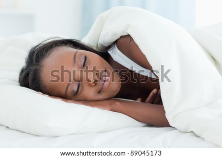 Radiant woman sleeping in her bedroom