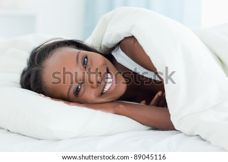 Radiant woman waking up in her bedroom