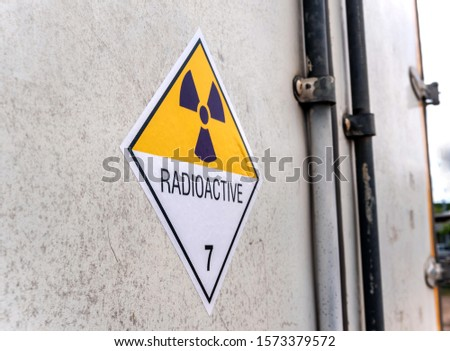 Radiation warning sign on the Hazardous materials transport label Class 7 at the aluminum container of transport truck