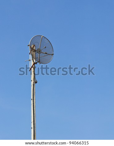 Radio communications tower and blue sky