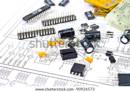 Radio components against electrical circuit - stock photo