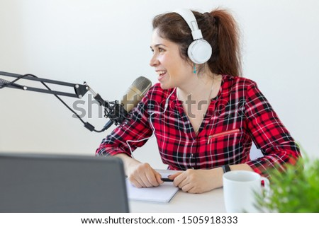 Radio host, blogging, broadcasting concept - young woman working on the radio