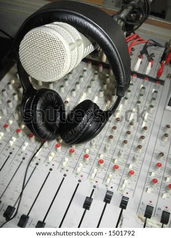 Radio studio detail: microphone, headphones and mixer