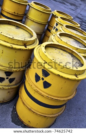 radioactive warning symbol on yellow tuns of toxic waste