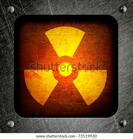 radioactivity symbol on a grungy barrel background