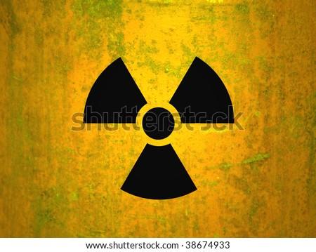 radioactivity symbol on a yellow grungy barrel background