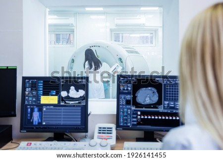 Radiologist in the control room of computed tomography at hospital Stok fotoğraf ©