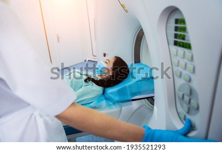 Radiologist with a female patient in the room of computed tomography Stock photo ©