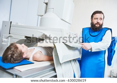 Radiology specialist at work. male radiologist in protective wear