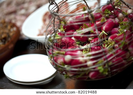 Radish in a salad basket on a table - stock photo