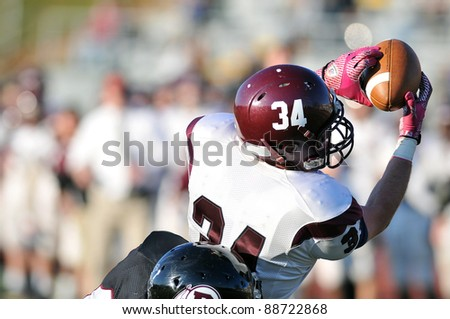 RADNOR, PA - NOVEMBER 12: A Lower Merion receiver (#15) makes a leaping catch  during the 115th meeting of Radnor and Lower Merion High School football teams November 12, 2011 in Radnor, PA