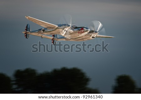 RADOM, POLAND - AUGUST 28: Red Bull P-38 Lightning takes off for its show during Air Show Radom on August 28, 2011