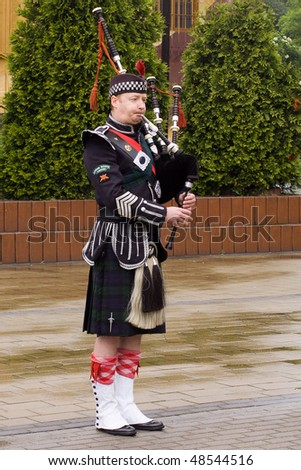 """RADZIONKOW - MAY 30: the show of """"drums and pipes"""" scottish music group during military rally cars on May 30, 2009 in Radzionkow, Poland"""