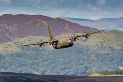 RAF Green Lockheed C-130 Hercules flying at Low level in the United Kingdom.
