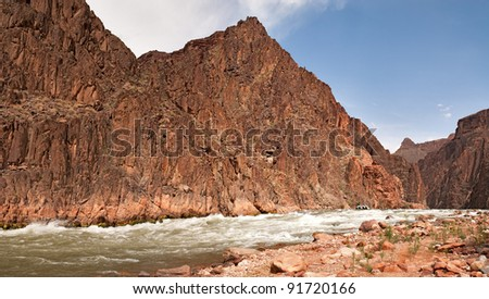 Raft approaching Granite Rapids in Grand Canyon National Park.