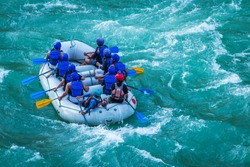 Raft in mid of River Ganges Rishikesh India.  White water  rafting water sports in Asia