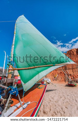 Raft or Jangada is typical fishing boat at Canoa Quebrada Beach. Raft or Jangada is typical fishing boat from the Brazil's Northeast.