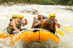 raft water white team sport activity whitewater extreme group rapids crowd of mixed tourist men and women with guided by professional pilot on whitewater creek rafting in ecuador raft water white team