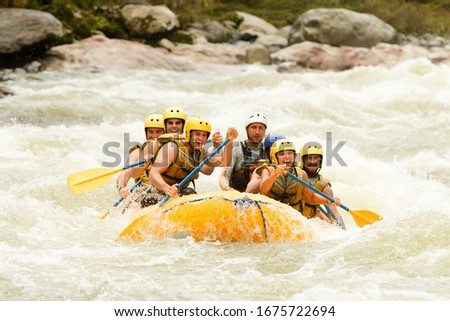 raft water white teamwork ecuador fun woman rapids people men gathering of mixed visitor men and women with guided by professional pilot on whitewater waterway rafting in ecuador raft water white team Foto stock ©